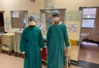 Linda Boloko on the left and Graeme Meintjes on the right, dressed in full PPE